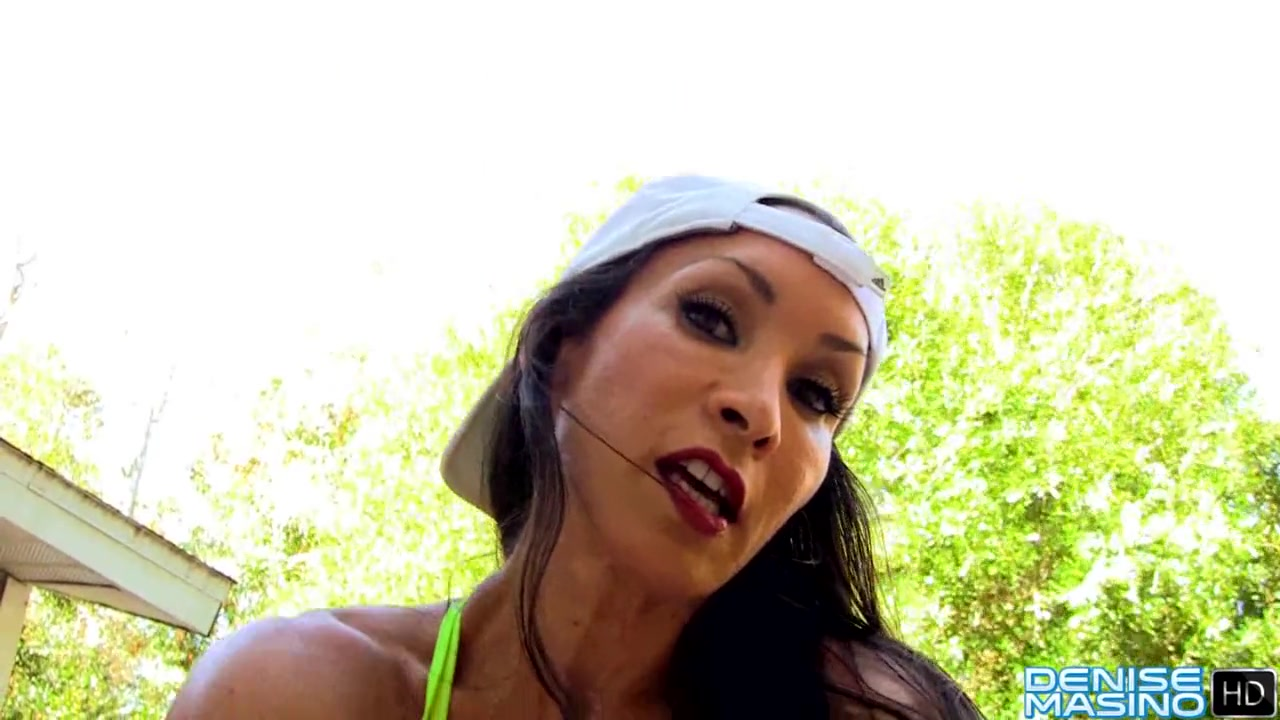 dark-haired bodybuilder shows hairy pussy and big clit in training